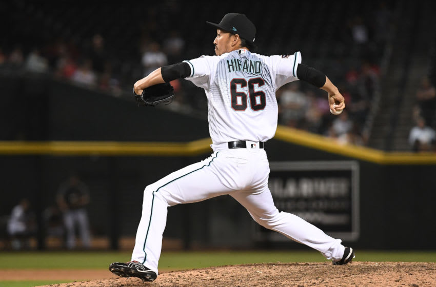 PHOENIX, AZ - SEPTEMBER 06: Yoshihisa Hirano #66 of the Arizona Diamondbacks delivers a pitch in the tenth inning of the MLB game against the Atlanta Braves at Chase Field on September 6, 2018 in Phoenix, Arizona. The Atlanta Braves won 7-6. (Photo by Jennifer Stewart/Getty Images)