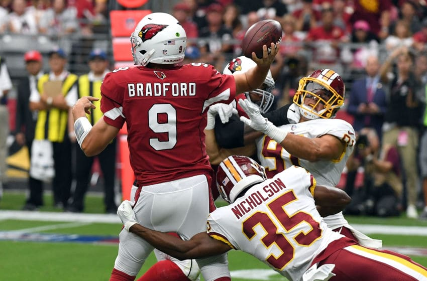 GLENDALE, AZ - SEPTEMBER 09: Quarterback Sam Bradford #9 of the Arizona Cardinals throws under pressure from defensive back Montae Nicholson #35 and linebacker Ryan Kerrigan #91 of the Washington Redskins during the first half at State Farm Stadium on September 9, 2018 in Glendale, Arizona. (Photo by Norm Hall/Getty Images)