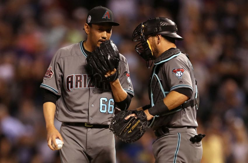 DENVER, CO - SEPTEMBER 11: Pitcher Yoshihisa Hirano #66 of the Arizona Diamondbacks confers with catcher Jeff Mathis #2 in the ninth inning against the Colorado Rockies at Coors Field on September 11, 2018 in Denver, Colorado. (Photo by Matthew Stockman/Getty Images)