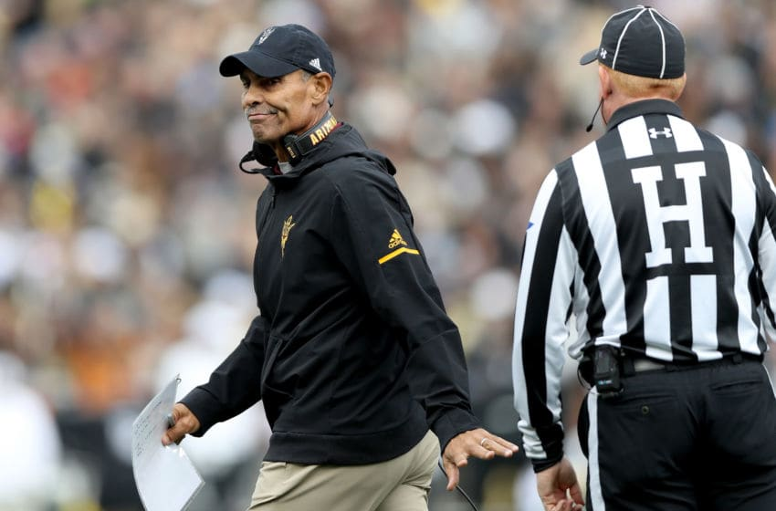 BOULDER, CO - OCTOBER 06: Head coach Herm Edwards of the Arizona State Sun Devils confers with Head Linesman Bob Day in the first quarter against the Colorado Buffaloes at Folsom Field on October 6, 2018 in Boulder, Colorado. (Photo by Matthew Stockman/Getty Images)