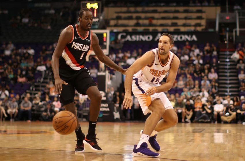 PHOENIX, AZ - OCTOBER 05: Ryan Anderson #15 of the Phoenix Suns passes the ball around Al-Farouq Aminu #8 of the Portland Trail Blazers during the NBA preseason game at Talking Stick Resort Arena on October 5, 2018 in Phoenix, Arizona. NOTE TO USER: User expressly acknowledges and agrees that, by downloading and or using this photograph, User is consenting to the terms and conditions of the Getty Images License Agreement. (Photo by Christian Petersen/Getty Images)