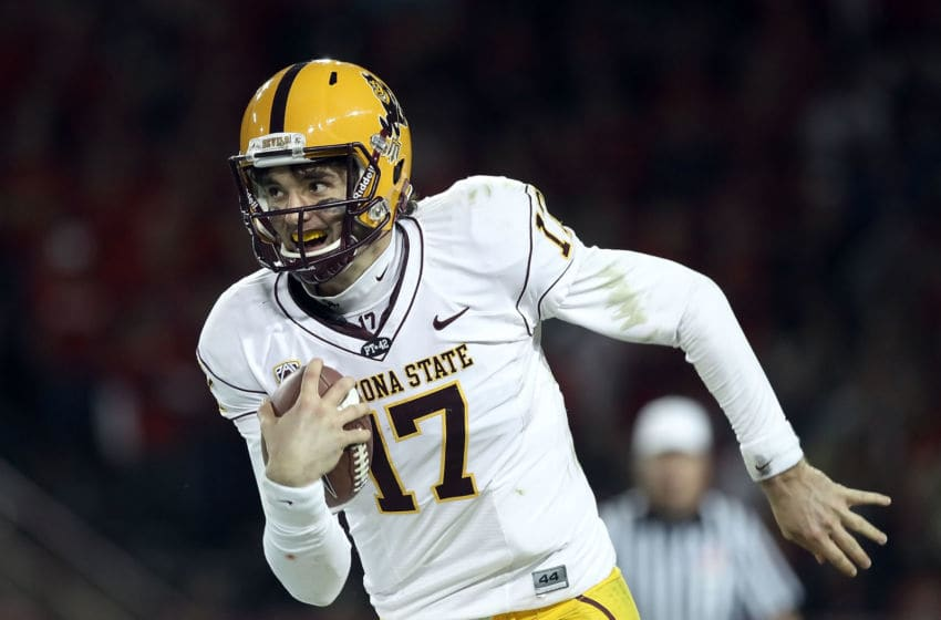 TUCSON, AZ - DECEMBER 02: Quarterback Brock Osweiler #17 of the Arizona State Sun Devils scrambles with the football during the college football game at Arizona Stadium on December 2, 2010 in Tucson, Arizona. The Sun Devils defeated the Wildcats 30-29 in double overtime. (Photo by Christian Petersen/Getty Images)