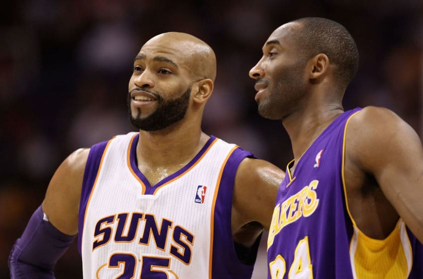 PHOENIX - JANUARY 05: Vince Carter #25 of the Phoenix Suns and Kobe Bryant #24 of the Los Angeles Lakers during the NBA game at US Airways Center on January 5, 2011 in Phoenix, Arizona. The Lakers defeated the Suns 99-95. NOTE TO USER: User expressly acknowledges and agrees that, by downloading and or using this photograph, User is consenting to the terms and conditions of the Getty Images License Agreement. (Photo by Christian Petersen/Getty Images)