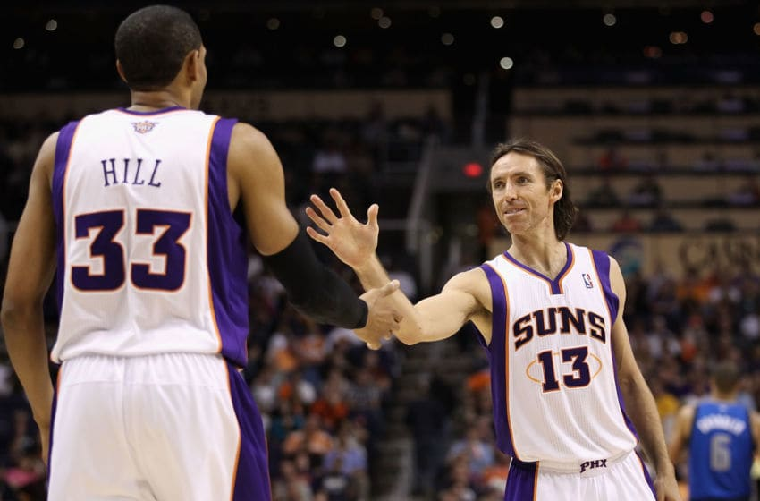 PHOENIX, AZ - MARCH 27: Steve Nash #13 of the Phoenix Suns high-fives teammate Grant Hill #33 during the NBA game against the Dallas Mavericks at US Airways Center on March 27, 2011 in Phoenix, Arizona. The Mavericks defeated the Suns 91-83. NOTE TO USER: User expressly acknowledges and agrees that, by downloading and or using this photograph, User is consenting to the terms and conditions of the Getty Images License Agreement. (Photo by Christian Petersen/Getty Images)