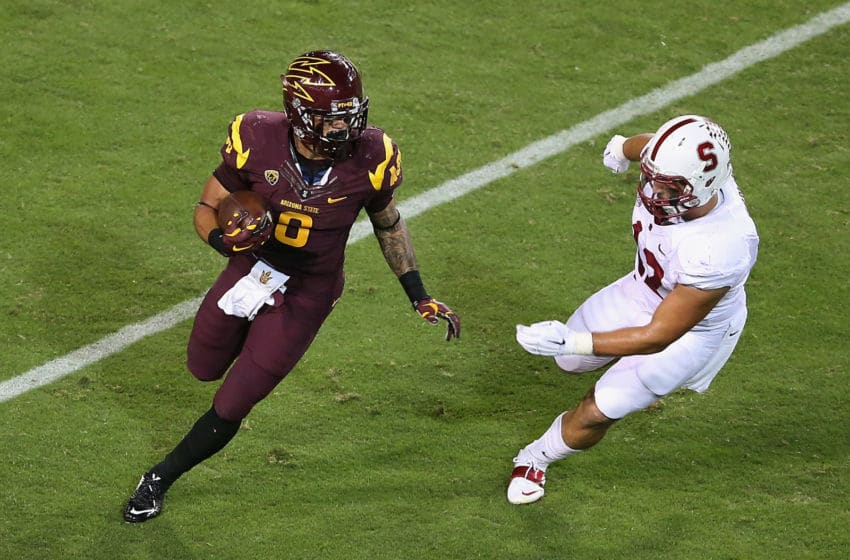 TEMPE, AZ - OCTOBER 18: Running back D.J. Foster #8 of the Arizona State Sun Devils rushes the football against linebacker A.J. Tarpley #17 of the Stanford Cardinal during the first quarter of the college football game at Sun Devil Stadium on October 18, 2014 in Tempe, Arizona. (Photo by Christian Petersen/Getty Images)
