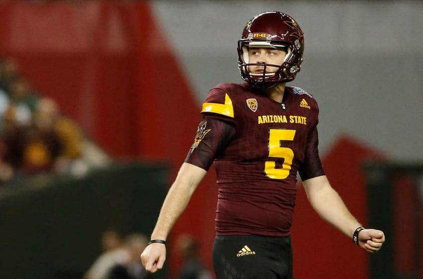 PHOENIX, AZ - JANUARY 02: Place kicker Zane Gonzalez #5 of the Arizona State Sun Devils walks off the field after a missed field goal against the West Virginia Mountaineers during the Motel 6 Cactus Bowl at Chase Field on January 2, 2016 in Phoenix, Arizona. The Mountaineers defeated the Sun Devils 43-42. (Photo by Christian Petersen/Getty Images)
