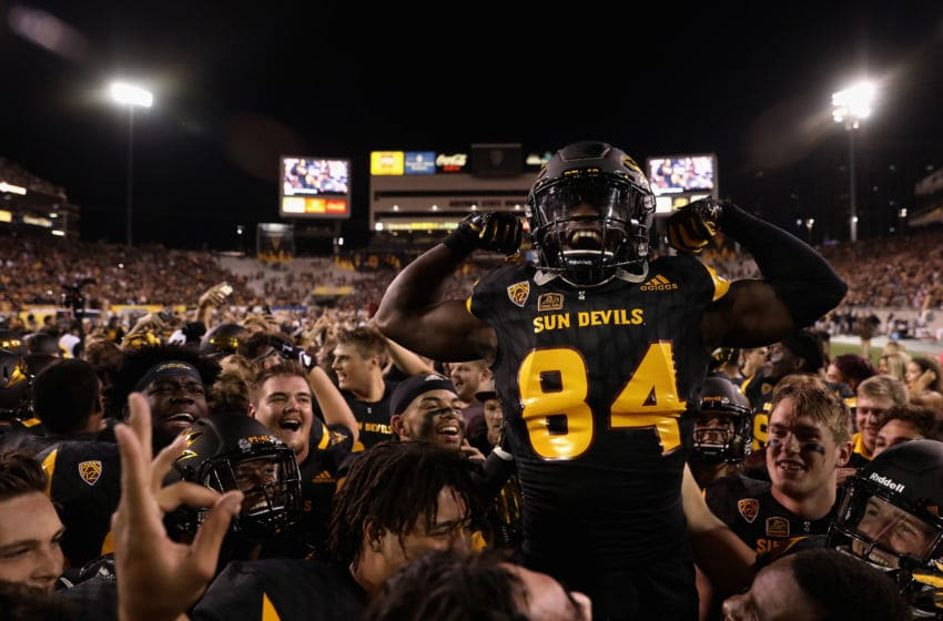TEMPE, AZ - OCTOBER 14: Wide receiver Frank Darby #84 of the Arizona State Sun Devils celebrates with teammates on the field after defeating the Washington Huskies in the college football game at Sun Devil Stadium on October 14, 2017 in Tempe, Arizona. The Sun Devils defeated the Huskies 13-7. (Photo by Christian Petersen/Getty Images)