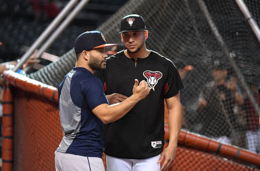 PHOENIX, AZ - MAY 04: Jose Altuve #27 of the Houston Astros talks with David Peralta #6 of the Arizona Diamondbacks prior to a game at Chase Field on May 4, 2018 in Phoenix, Arizona. (Photo by Norm Hall/Getty Images)