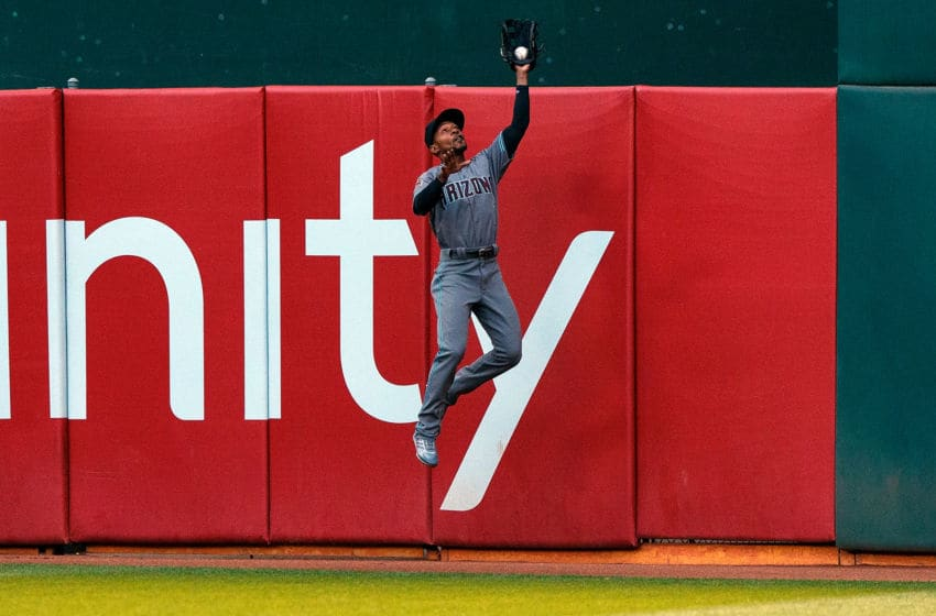 OAKLAND, CA - MAY 25: Jarrod Dyson #1 of the Arizona Diamondbacks catches a fly ball hit off the bat of Chad Pinder (not pictured) of the Oakland Athletics during the third inning at the Oakland Coliseum on May 25, 2018 in Oakland, California. The Arizona Diamondbacks defeated the Oakland Athletics 7-1. (Photo by Jason O. Watson/Getty Images)