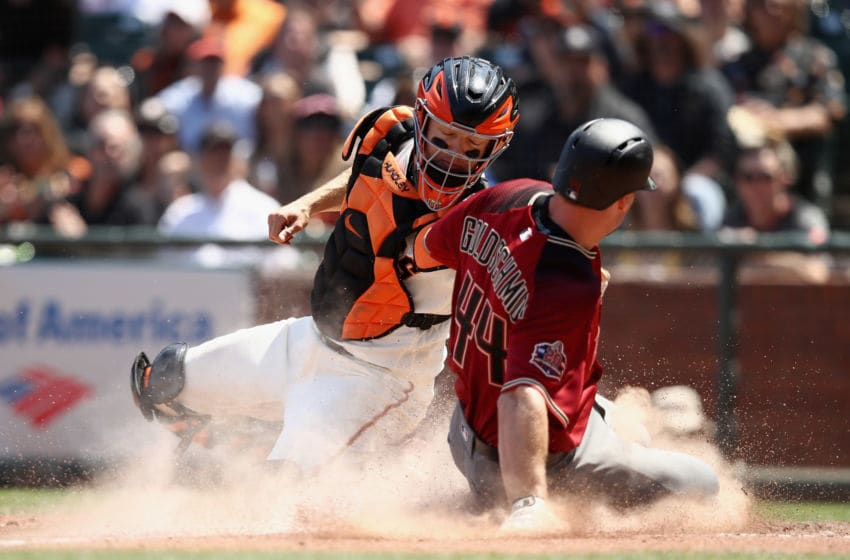 SAN FRANCISCO, CA - JUNE 06: Paul Goldschmidt #44 of the Arizona Diamondbacks is tagged out at home plate by Nick Hundley #5 of the San Francisco Giants in the sixth inning at AT&T Park on June 6, 2018 in San Francisco, California. (Photo by Ezra Shaw/Getty Images)