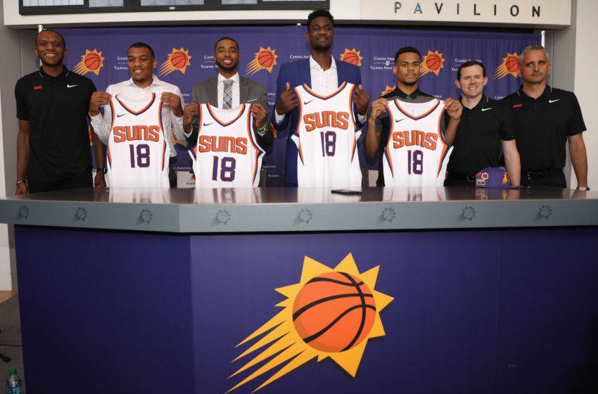PHOENIX, AZ - JUNE 22: (L-R) James Jones, George King, Mikal Bridges, Deandre Ayton, Elie Okoo, general Manager Ryan McDonough and head coach Igor Kokoskov of the Pheonix Suns pose together following press conference at Talking Stick Resort Arena on June 22, 2018 in Phoenix, Arizona. NOTE TO USER: User expressly acknowledges and agrees that, by downloading and or using this photograph, User is consenting to the terms and conditions of the Getty Images License Agreement. (Photo by Christian Petersen/Getty Images)