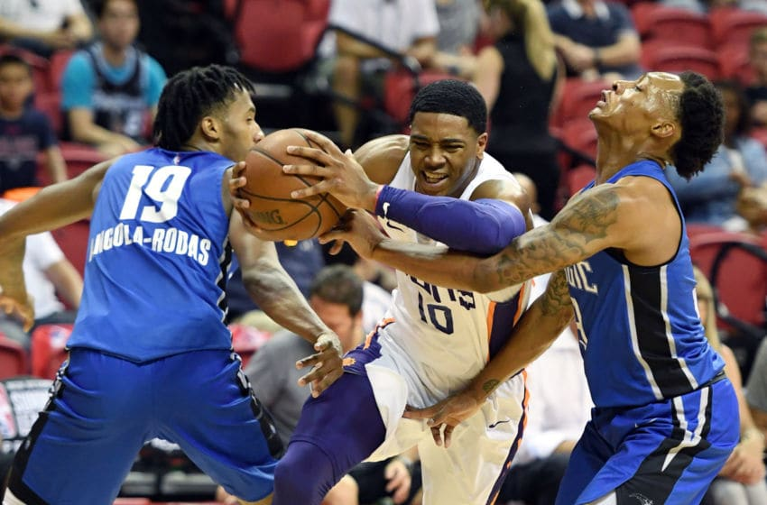 LAS VEGAS, NV - JULY 09: Shaquille Harrison #10 of the Phoenix Suns drives between Braian Angola-Rodas #19 and Jay Wright #3 of the Orlando Magic during the 2018 NBA Summer League at the Thomas & Mack Center on July 9, 2018 in Las Vegas, Nevada. The Suns defeated the Magic 71-53. NOTE TO USER: User expressly acknowledges and agrees that, by downloading and or using this photograph, User is consenting to the terms and conditions of the Getty Images License Agreement. (Photo by Ethan Miller/Getty Images)