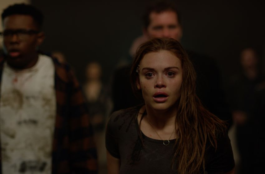 """(L-R) Denzel Whitaker as Thomas and Holland Roden as Erin in the horror/thriller film """"NO ESCAPE"""" a Vertical Entertainment release. Photo courtesy of Vertical Entertainment."""