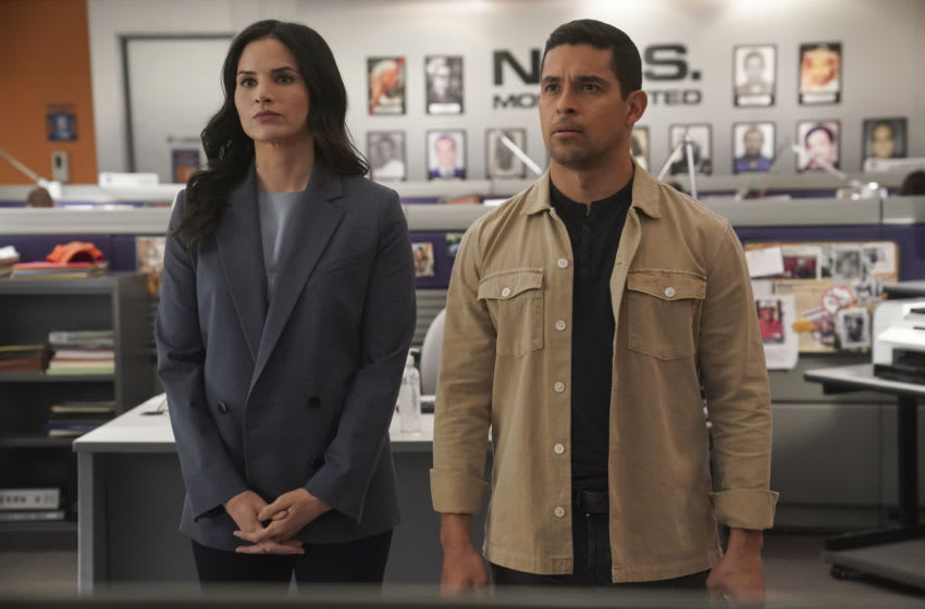"""""""Blown Away"""" – When members of an NCIS Regional Enforcement Action Capabilities Training Team (REACT) are killed during an explosion, NCIS Special Agent Jessica Knight (Katrina Law), the lone surviving member, helps crack the case using high tech body armor, on NCIS, Tuesday, May 18 (8:00-9:00 PM, ET/PT) on the CBS Television Network. Pam Dawber returns as investigative journalist Marcie Warren. Pictured: Katrina Law as NCIS Special Agent Jessica Knight, Wilmer Valderrama as NCIS Special Agent Nicholas """"Nick"""" Torres. . Photo: Sonja Flemming/CBS ©2021 CBS Broadcasting, Inc. All Rights Reserved."""