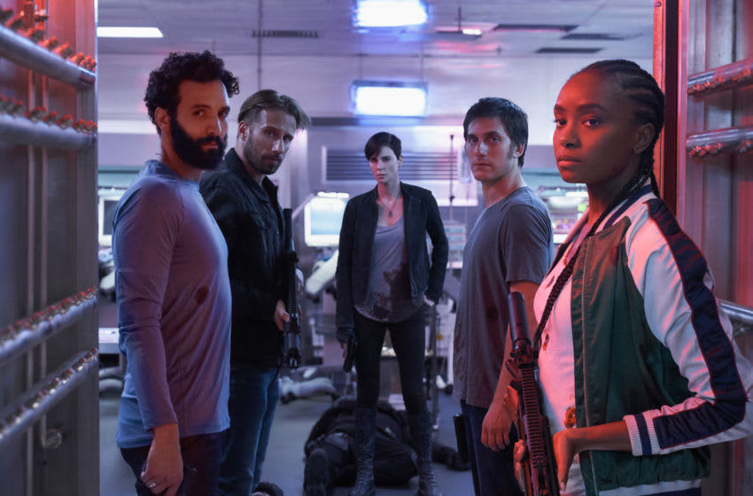 THE OLD GUARD (2020) - (L to R) Marwan Kenzari as Joe, Matthias Schoenaerts as Booker, Charlize Theron as Andy, Luca Marinelli as Nicky, Kiki Layne as Nile. Photo Credit: AIMEE SPINKS/NETFLIX ©2020