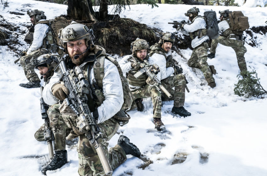 """""""God of War"""" – Bravo Team enters enemy territory in the snowy Spin Ghar Mountain Range to capture Al-Hazred, the leader of a terrorist group and son of the terrorist leader that Jason took down early in his career, and made him Bravo One. When they are attacked, Jason and Cerberus, Bravo's canine member, are separated from the team, in part one of the two-part fourth season premiere of SEAL TEAM, Wednesday, Nov. 25 (9:00-10:00 PM, ET/PT) on the CBS Television Network. The dramatic season premiere was directed by Bravo One himself, David Boreanaz. Pictured L to R: Neil Brown Jr. as Ray Perry, AJ Buckley as Sonny Quinn, Max Thieriot as Clay Spenser, and Tim Chiou as Michael """"Thirty Mike"""" Chen. Photo: Erik Voake/CBS ©2020 CBS Broadcasting, Inc. All Rights Reserved."""