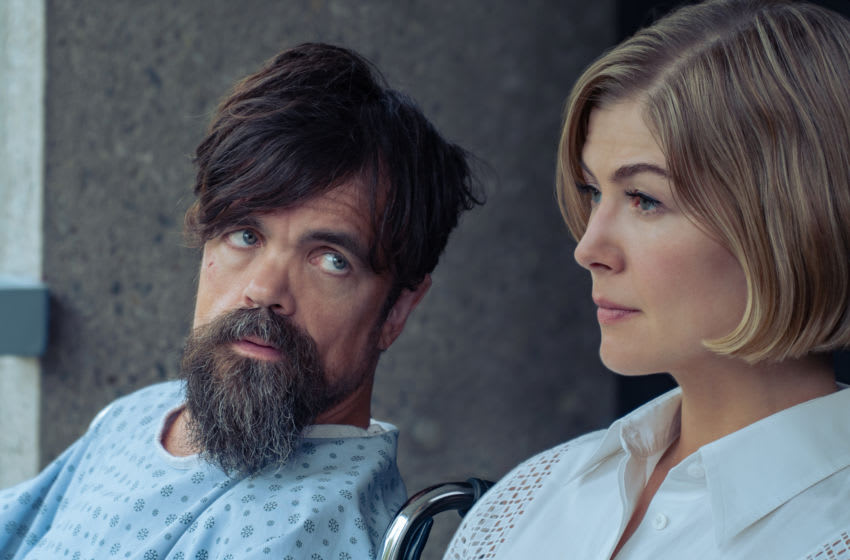 I CARE A LOT (2021) Peter Dinklage as Rukov and Rosamund Pike as Marla. Cr: Seacia Pavao/NETFLIX