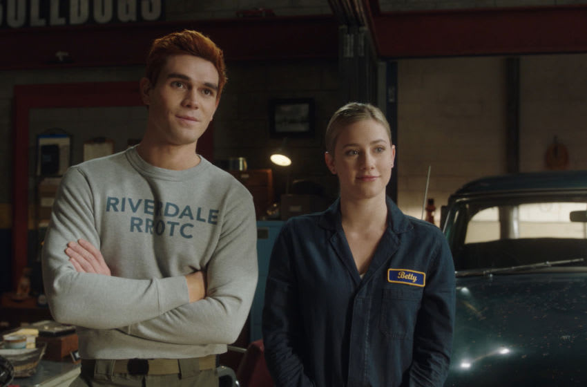 """Riverdale -- """"Chapter Eighty-Two: Back To School"""" -- Image Number: RVD506fg_0001r -- Pictured (L-R): KJ Apa as Archie Andrews and Lili Reinhart as Betty Cooper -- Photo: The CW -- © 2021 The CW Network, LLC. All Rights Reserved."""