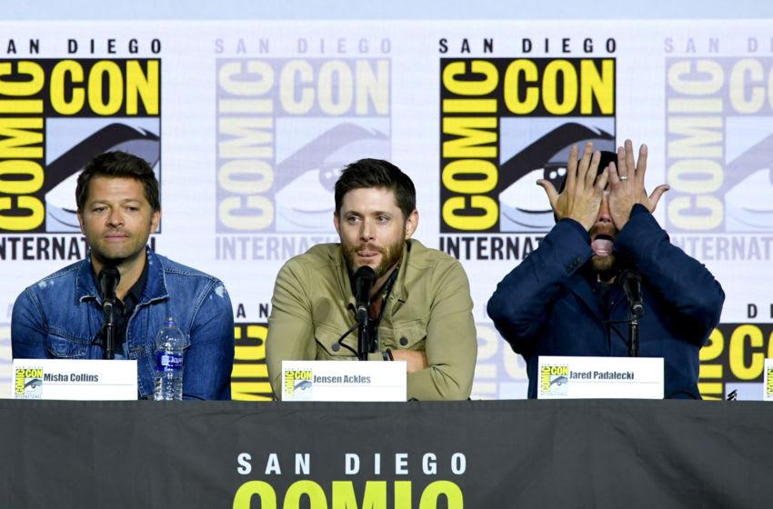 SAN DIEGO, CALIFORNIA - JULY 21: Misha Collins, Jensen Ackles, and Jared Padalecki speak at the