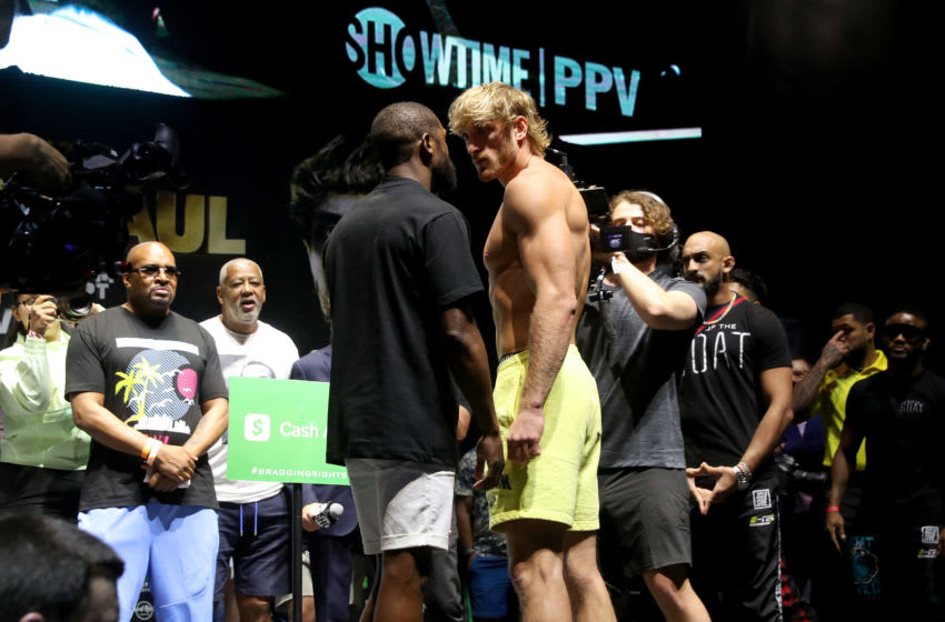 MIAMI GARDENS, FLORIDA - JUNE 05: Floyd Mayweather and Logan Paul face off during the weigh-in ahead of the June 6th exhibition boxing match between Floyd Mayweather and Logan Paul on June 5, 2021 at Hard Rock Live at Seminole Hard Rock Casino in Miami Gardens, Florida. (Photo by Johnny Nunez/Getty Images)