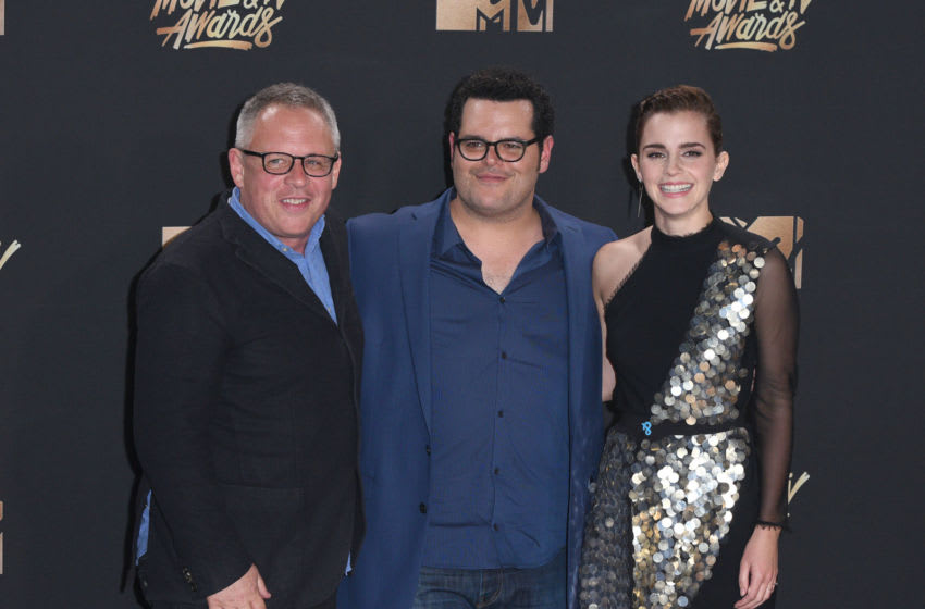 LOS ANGELES, CA - MAY 07: Director Bill Condon and actors Josh Gad and Emma Watson, winners of Movie of the Year for 'Beauty and the Beast', pose in the press room at the 2017 MTV Movie and TV Awards at The Shrine Auditorium on May 7, 2017 in Los Angeles, California. (Photo by C Flanigan/Getty Images)