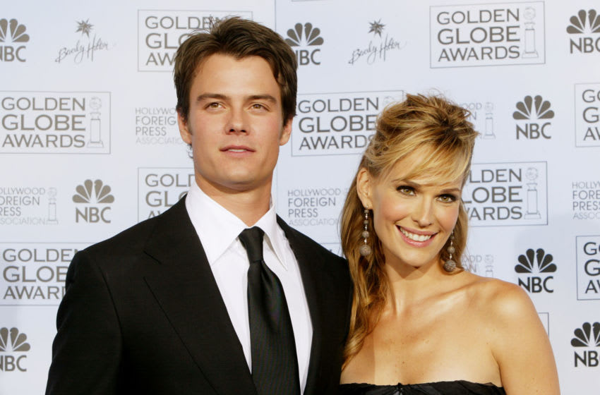 BEVERLY HILLS, CA - JANUARY 25: Presenters Actress Molly Sims and actor Josh Duhamel pose backstage at the 61st Annual Golden Globe Awards at the Beverly Hilton Hotel on January 25, 2004 in Beverly Hills, California. (Photo by Kevin Winter/Getty Images)