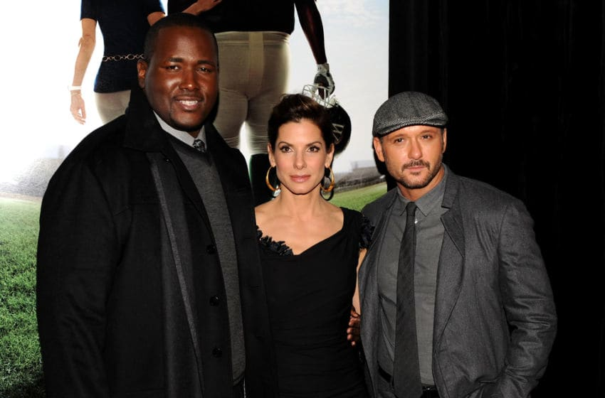 NEW YORK - NOVEMBER 17: (L-R) Actor Quinton Aaron, Sandra Bullock and Tim McGraw attend the premiere of
