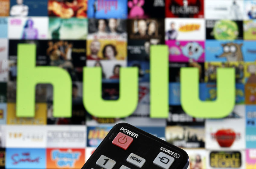 PARIS, FRANCE - MARCH 28: In this photo illustration, a remote control is seen in front of a television screen showing a Hulu logo on March 28, 2020 in Paris, France. As the Coronavirus moves to the U.S., Disney has announced that it will provide a free 24/7 ABC news feed to Hulu Live to On-Demand subscribers. (Photo Illustration by Chesnot/Getty Images)