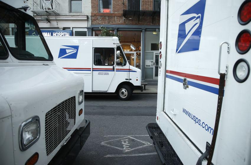 US Postal Service (USPS) trucks (Photo by John Lamparski/Getty Images)