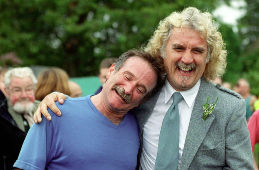 377177 05: Actor and comedian Robin Williams, left, is greeted by his friend, comedian Billy Connolly, after taking part in the Hill Race at the Lonach Highland Games, August 28, 2000 in Scotland. (Photo by Julian Parker/Liaison)
