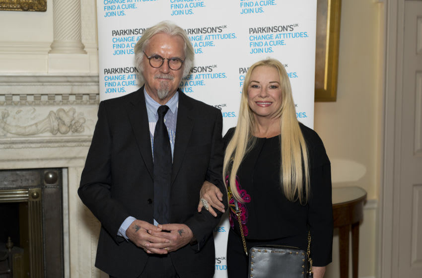 LONDON, ENGLAND - OCTOBER 30: Sir Billy Connolly with his wife Pamela Stephenson during a reception to mark 200 years since Dr James Parkinson published 'An Essay on the Shaking Palsy' at 10 Downing Street on October 30, 2017 in London, England. Dr James Parkinson published 'An Essay on the Shaking Palsy' in 1817, which established Parkinson's as a recognised medical condition. (Photo by Geoff Pugh - WPA Pool / Getty Images)