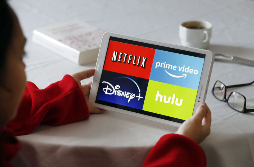 PARIS, FRANCE - NOVEMBER 20: In this photo illustration, the logos of media service providers, Netflix, Amazon Prime Video, Disney + and Hulu are displayed on the screen of a tablet on November 20, 2019 in Paris, France. Amazon Prime video is a major player in streaming as its competitors, Disney, Netflix, Disney +, HBO and Apple TV. (Photo by Chesnot/Getty Images)
