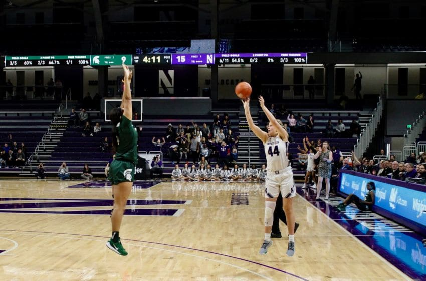 Northwestern's Abi Scheid shoots against Michigan State on Feb. 10. Photo courtesy of Andy Brown