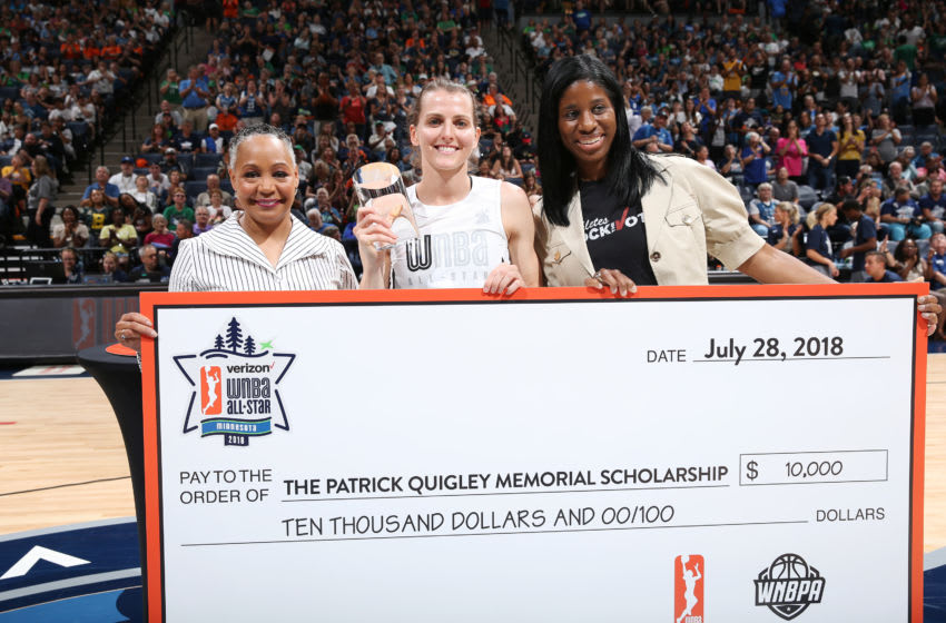 MINNEAPOLIS, MN - JULY 28: WNBA President Lisa Borders presents Allie Quigley #14 of the Chicago Sky with the Trophy during the Three-Point Contest during halftime during the Verizon WNBA All-Star Game 2018 on July 28, 2018 at the Target Center in Minneapolis, Minnesota. NOTE TO USER: User expressly acknowledges and agrees that, by downloading and/or using this photograph, user is consenting to the terms and conditions of the Getty Images License Agreement. Mandatory Copyright Notice: Copyright 2018 NBAE (Photo by David Sherman/NBAE via Getty Images)