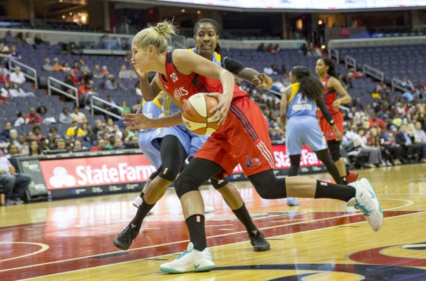 WASHINGTON, DC - MAY 26: Washington Mystics guard Elena Delle Donne (11) dribbles past Chicago Sky forward Jessica Breland (51) during a WNBA women's basketball game between the Washington Mystics and the Chicago Sky on May 26, 2017 at Verizon Center in Washington DC. (Photo by Tony Quinn/Icon Sportswire via Getty Images)