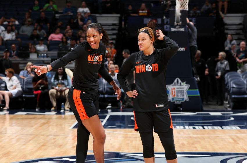 MINNEAPOLIS - JULY 27: A'Ja Wilson #22 and Kayla McBride #21 of Team Delle Donne look on during WNBA All-Star Practice and Media Availability 2018 on July 27, 2018 at the Target Center in Minneapolis, Minnesota. NOTE TO USER: User expressly acknowledges and agrees that, by downloading and/or using this photograph, user is consenting to the terms and conditions of the Getty Images License Agreement. Mandatory Copyright Notice: Copyright 2018 NBAE (Photo by David Sherman/NBAE via Getty Images)