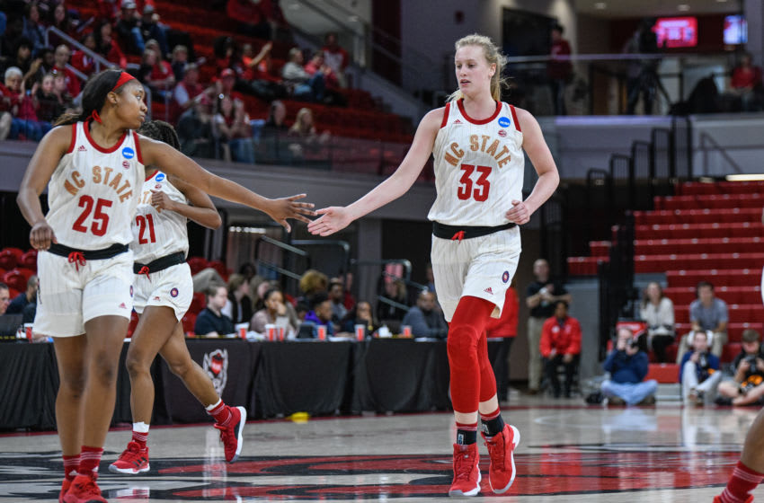 RALEIGH, NC - MARCH 23: NC State Wolfpack center Elissa Cunane (33) and NC State Wolfpack forward Kayla Jones (25) celebrate after the bucket during the 2019 Div 1 Women's Championship - First Round college basketball game between the Maine Black Bears and NC State Wolfpack on March 23, 2019, at Reynolds Coliseum in Raleigh, NC. (Photo by Michael Berg/Icon Sportswire via Getty Images)