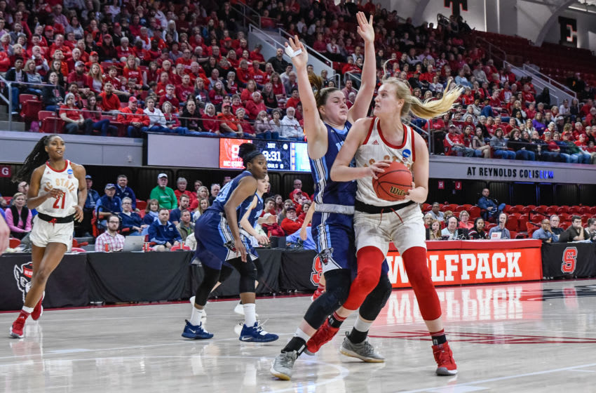 RALEIGH, NC - MARCH 23: NC State Wolfpack center Elissa Cunane (33) fights for position during the 2019 Div 1 Women's Championship - First Round college basketball game between the Maine Black Bears and NC State Wolfpack on March 23, 2019, at Reynolds Coliseum in Raleigh, NC. (Photo by Michael Berg/Icon Sportswire via Getty Images)