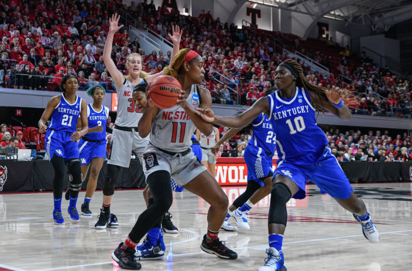 RALEIGH, NC - MARCH 25: NC State Wolfpack guard Kiara Leslie (11) looks for the open person during the 2019 Div 1 Championship - Second Round college basketball game between the Kentucky Wildcats and the NC State Wolfpack on March 25, 2019 at Reynolds Coliseum in Raleigh, NC. (Photo by Michael Berg/Icon Sportswire via Getty Images)