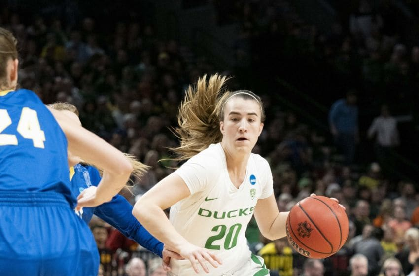 PORTLAND, OR - MARCH 29: Oregon Ducks guard Sabrina Ionescu (20) goes in for a basket during the NCAA Division I Women's Championship third round basketball game between the South Dakota State Jackrabbits and the Oregon Ducks on March 29, 2019 at Moda Center in Portland, Oregon. (Photo by Joseph Weiser/Icon Sportswire via Getty Images)
