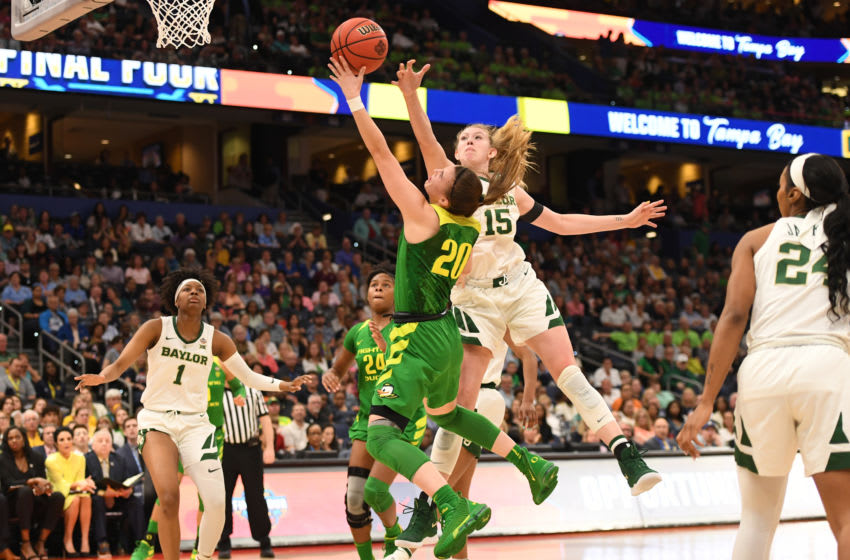 TAMPA, FL - APRIL 05: Sabrina Ionescu #20 of the Oregon Ducks tries to shoot over Lauren Cox #15 of the Baylor Bears at Amalie Arena on April 5, 2019 in Tampa, Florida. (Photo by Justin Tafoya/NCAA Photos via Getty Images)