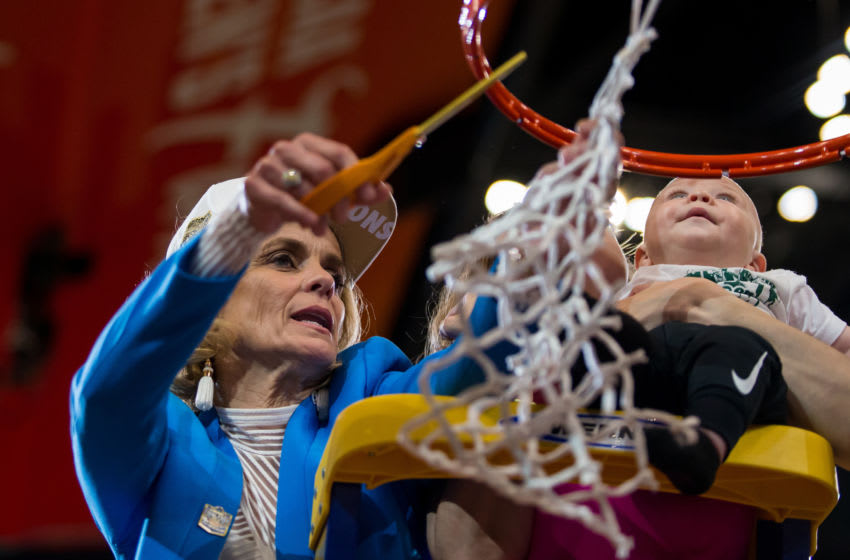 TAMPA, FL - APRIL 07: Baylor head coach Kim Mulkey cuts down the net with her daughter and grandson after winning the NCAA Division I Women's National Championship Game against the Notre Dame Fighting Irish on April 07, 2019, at Amalie Arena in Tampa, Florida. (Photo by Mary Holt/Icon Sportswire via Getty Images)