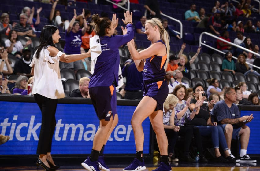 PHOENIX, AZ- MAY 11: Sophie Cunningham #9 of the Phoenix Mercury hi-fives teammates during a pre-season game on May 11, 2019 at the Talking Stick Resort Arena, in Phoenix, Arizona. NOTE TO USER: User expressly acknowledges and agrees that, by downloading and or using this photograph, User is consenting to the terms and conditions of the Getty Images License Agreement. Mandatory Copyright Notice: Copyright 2019 NBAE (Photo by Barry Gossage/NBAE via Getty Images)