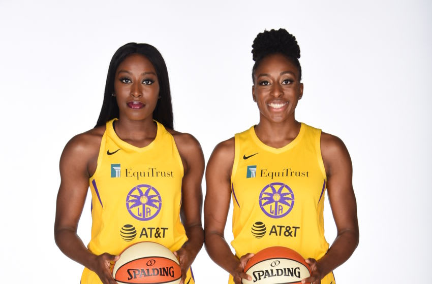 LOS ANGELES CA - MAY 14: Chiney Ogwumike #13 and Nneka Ogwumike #30 poses for a portrait during the Los Angeles Sparks Media Day at Southwest College on May 14, 2019 in Los Angeles, California. NOTE TO USER: User expressly acknowledges and agrees that, by downloading and or using this Photograph, user is consenting to the terms and condition of the Getty Images License Agreement. Mandatory Copyright Notice: 2018 NBAE (Photo by Juan Ocampo/NBAE via Getty Images)