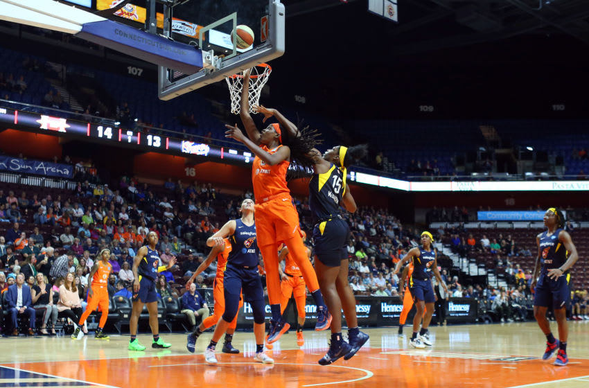 UNCASVILLE, CT - MAY 28: Connecticut Sun forward Jonquel Jones (35) shoots over Indiana Fever center Teaira McCowan (15) during a WNBA game between Indiana Fever and Connecticut Sun on May 28, 2019, at Mohegan Sun Arena in Uncasville, CT. (Photo by M. Anthony Nesmith/Icon Sportswire via Getty Images)