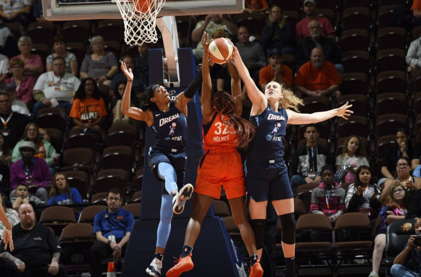 UNCASVILLE, CT - JUNE 21: Brittney Sykes #7 and Marie Gülich #24 of Atlanta Dream block Bria Holmes #32 of the Connecticut Sun on June 21, 2019 at the Mohegan Sun Arena in Uncasville, Connecticut. NOTE TO USER: User expressly acknowledges and agrees that, by downloading and or using this photograph, User is consenting to the terms and conditions of the Getty Images License Agreement. Mandatory Copyright Notice: Copyright 2019 NBAE (Photo by Khoi Ton/NBAE via Getty Images)