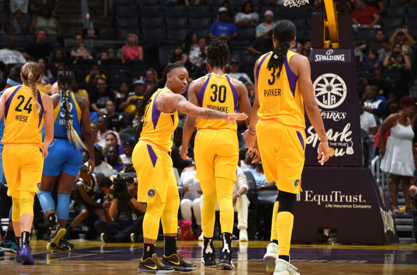LOS ANGELES, CA - JUNE 30: Riquna Williams #2 high-fives Candace Parker #3 of the Los Angeles Sparks against the Chicago Sky on June 30, 2019 at the Staples Center in Los Angeles, California NOTE TO USER: User expressly acknowledges and agrees that, by downloading and or using this photograph, User is consenting to the terms and conditions of the Getty Images License Agreement. Mandatory Copyright Notice: Copyright 2019 NBAE (Photo by Adam Pantozzi/NBAE via Getty Images)