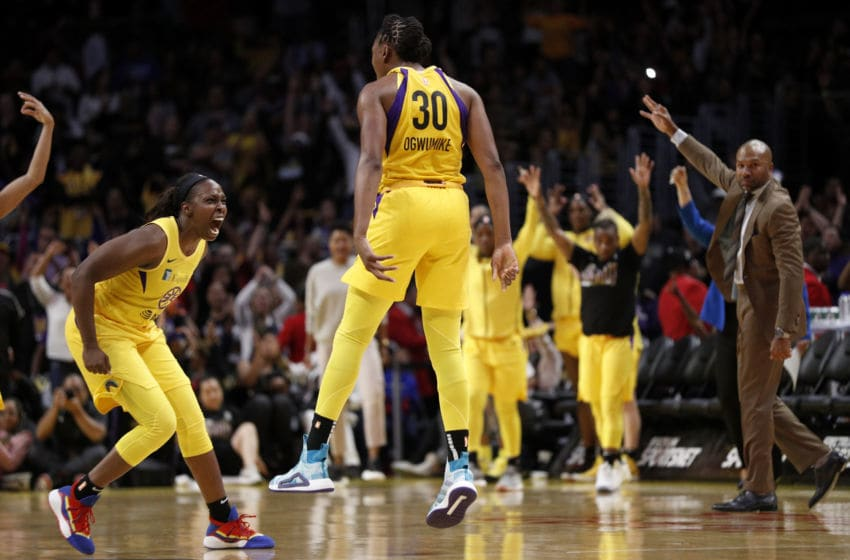 LOS ANGELES, CALIFORNIA - MAY 31: Forward Nneka Ogwumike #30 of the Los Angeles Sparks celebrates her basket with guard Chelsea Gray #12 in the game against the Connecticut Sun at Staples Center on May 31, 2019 in Los Angeles, California. NOTE TO USER: User expressly acknowledges and agrees that, by downloading and or using this photograph, User is consenting to the terms and conditions of the Getty Images License Agreement. (Photo by Meg Oliphant/Getty Images)