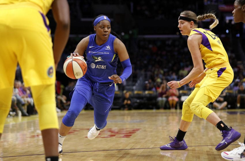 LOS ANGELES, CALIFORNIA - JULY 18: Guard Arike Ogunbowale #24 of the Dallas Wings handles the ball in the game against the Los Angeles Sparks at Staples Center on July 18, 2019 in Los Angeles, California. NOTE TO USER: User expressly acknowledges and agrees that, by downloading and or using this photograph, User is consenting to the terms and conditions of the Getty Images License Agreement. (Photo by Meg Oliphant/Getty Images)