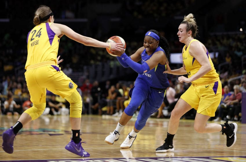 LOS ANGELES, CALIFORNIA - JULY 18: Guard Arike Ogunbowale #24 of the Dallas Wings moves the ball between guards Sydney Wiese #24 and Marina Mabrey #5 of the Los Angeles Sparks at Staples Center on July 18, 2019 in Los Angeles, California. NOTE TO USER: User expressly acknowledges and agrees that, by downloading and or using this photograph, User is consenting to the terms and conditions of the Getty Images License Agreement. (Photo by Meg Oliphant/Getty Images)